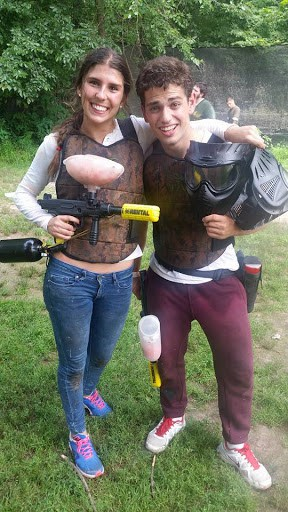 two teen paintball players