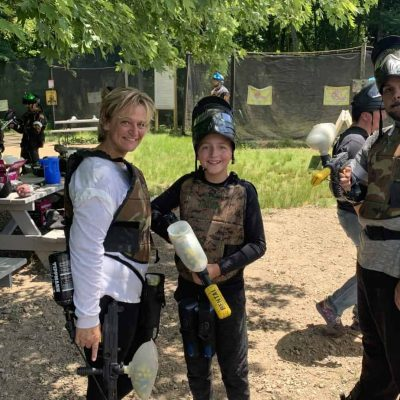 family playing low impact paintball