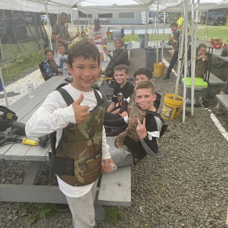 young boys at paintball birthday party