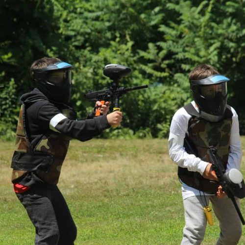 young paintball players on field