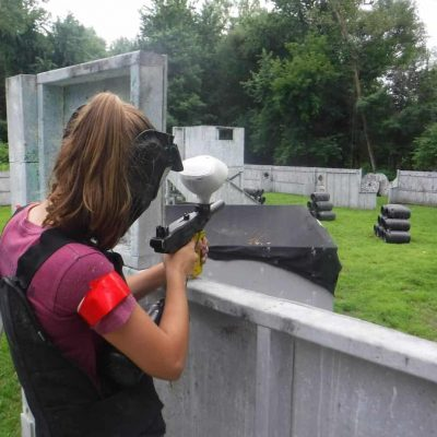 girl in youth group playing paintball