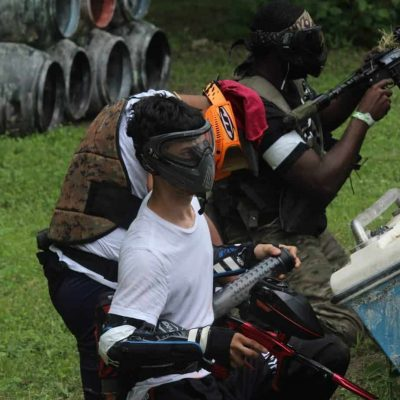 father and son playing low impact paintball