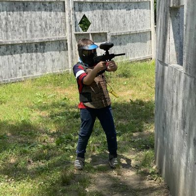 young boy shooting low impact paintball gun